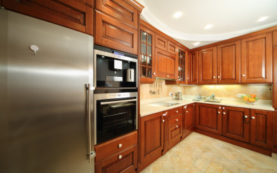 Light clean kitchen with wooden furniture, integrated oven
